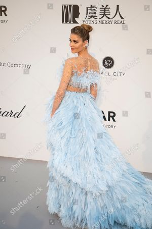 Ana Beatriz Barros poses for photographers upon arrival at the amfAR, Cinema Against AIDS, benefit at the Hotel du Cap-Eden-Roc, during the 72nd international Cannes film festival, in Cap d'Antibes, southern France