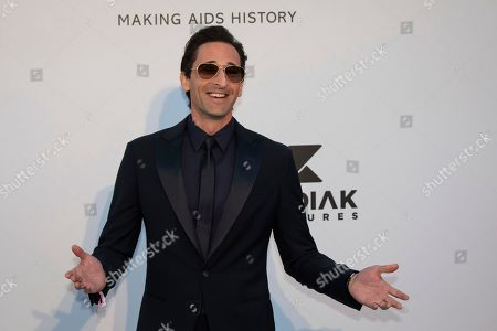 Adrien Brody poses for photographers upon arrival at the amfAR, Cinema Against AIDS, benefit at the Hotel du Cap-Eden-Roc, during the 72nd international Cannes film festival, in Cap d'Antibes, southern France
