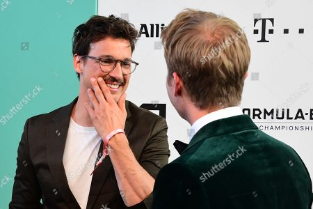 Stock Photo of Florian David Fitz (L) and former German Formula One driver Nico Rosberg (R) arrive for the Green Awards held on the occasion of the Green Festivals in Berlin, Germany, 24 May 2019.