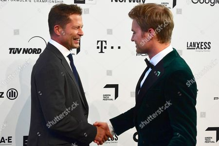 Til Schweiger (L) and former German Formula One driver Nico Rosberg (R) arrive for the Green Awards held on the occasion of the Green Festivals in Berlin, Germany, 24 May 2019.