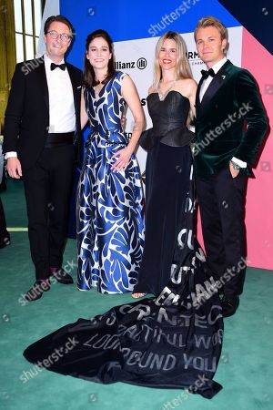 German Minister of Transport and Digital Infrastructure Andreas Scheuer (L) and his partner Julia Reuss (2-L) and Former German Formula One driver Nico Rosberg (R) and his wife Vivian Sibold (2-R) for the Green Awards held on the occasion of the Green Festivals in Berlin, Germany, 24 May 2019.