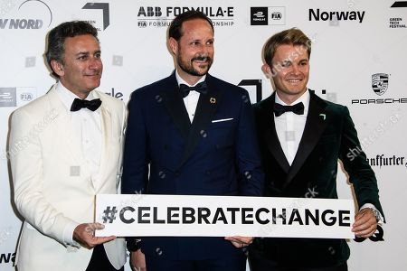 Formula E boss Alejandro Agag, Norwegian Crown Prince Haakon and Former German Formula One driver Nico Rosberg hold a banner #celebratechange as they arrive for the Green Awards held on the occasion of the Green Festivals in Berlin, Germany, 24 May 2019.