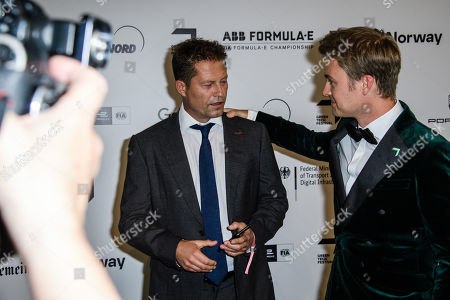 Stock Photo of Til Schweiger (L) and former German Formula One driver Nico Rosberg (R) say hello on their arrival for the Green Awards held on the occasion of the Green Festivals in Berlin, Germany, 24 May 2019.
