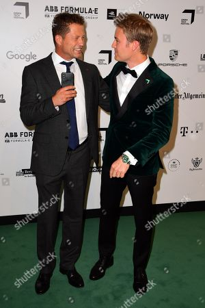 Til Schweiger (L) and former German Formula One driver Nico Rosberg arrive for the Green Awards held on the occasion of the Green Festivals in Berlin, Germany, 24 May 2019.
