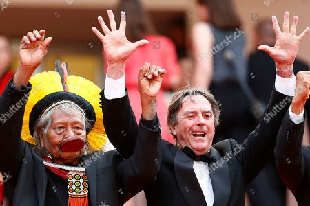 Chief Raoni Metuktire (L) of the Brazilian indigenous Kayapo people and Belgian writer Jean-Pierre Dutilleux (R) arrive for the screening of 'Sibyl' at the 72nd annual Cannes Film Festival, in Cannes, France, 24 May 2019. The movie is presented in the Official Competition of the festival which runs from 14 to 25 May.