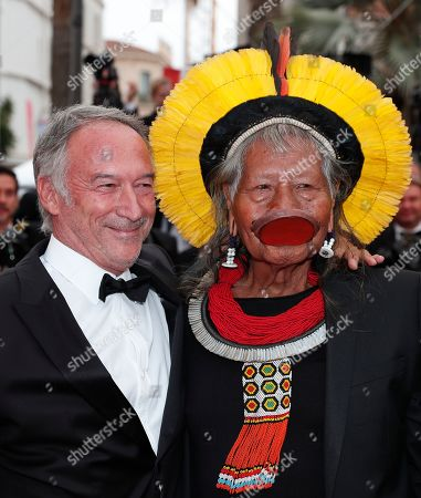 Chief Raoni Metuktire of the Brazilian indigenous Kayapo people (R) arrives for the screening of 'Sibyl' at the 72nd annual Cannes Film Festival, in Cannes, France, 24 May 2019. The movie is presented in the Official Competition of the festival which runs from 14 to 25 May.