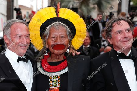 Chief Raoni Metuktire (C) of the Brazilian indigenous Kayapo people and Belgian writer Jean-Pierre Dutilleux (R) arrive for the screening of 'Sibyl' at the 72nd annual Cannes Film Festival, in Cannes, France, 24 May 2019. The movie is presented in the Official Competition of the festival which runs from 14 to 25 May.