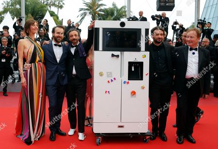 Team of the film 'Yves' with French actor and director Benoit Forgeard (3-L) and French actress Doria Tillier (L), French actor William Lebghil (2-R) pose with a fridge as they arrive for the screening of 'Sibyl' at the 72nd annual Cannes Film Festival, in Cannes, France, 24 May 2019. The movie is presented in the Official Competition of the festival which runs from 14 to 25 May.