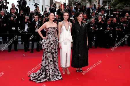 Stock Picture of Huang Lu, French actresses Stacy Martin and Amira Casar arrive for the screening of 'Sibyl' at the 72nd annual Cannes Film Festival, in Cannes, France, 24 May 2019. The movie is presented in the Official Competition of the festival which runs from 14 to 25 May.