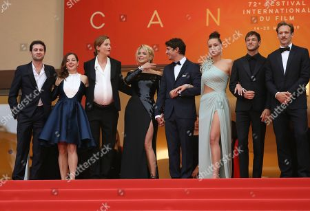 Arthur Harari, Laure Calamy, Justine Triet, Virginie Efira, Niels Schneider, Adele Exarchopoulos, Gaspard Ulliel, Paul Hamy. Arthur Harari, from left, Laure Calamy, director Justine Triet, actors Virginie Efira, Niels Schneider, Adele Exarchopoulos, Gaspard Ulliel and Paul Hamy pose for photographers upon arrival at the premiere of the film 'Sybil' at the 72nd international film festival, Cannes, southern France