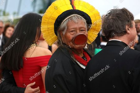 Chief Raoni Metuktire of the Kayapo people, center, poses for photographers upon arrival at the premiere of the film 'Sybil' at the 72nd international film festival, Cannes, southern France