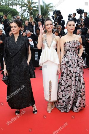 Amira Casar, Stacy Martin, Huang Lu. Actresses Amira Casar, from left, Stacy Martin and Huang Lu pose for photographers upon arrival at the premiere of the film 'Sybil' at the 72nd international film festival, Cannes, southern France