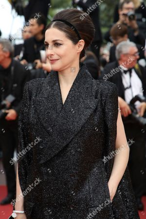 Amira Casar poses for photographers upon arrival at the premiere of the film 'Sybil' at the 72nd international film festival, Cannes, southern France