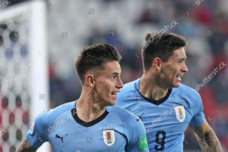 Uruguay's Paul Rodriguez, left, celebrates with Uruguay's Darwin Nunez, right, after Rodriguez scored his side's third goalduring the Group C U20 World Cup soccer match between Uruguay and Norway in Lodz, Poland
