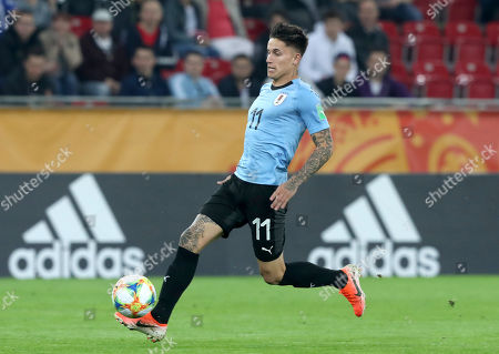 Uruguay's Paul Rodriguez scores his side's third goal during the Group C U20 World Cup soccer match between Uruguay and Norway in Lodz, Poland
