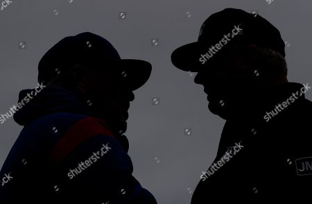 Joe Maddon, Bill Miller. Chicago Cubs manager Joe Maddon, left, talks with third base umpire Bill Miller before a baseball game against the Cincinnati Reds, in Chicago