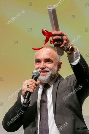 Karim Ainouz with the Un Certain Regard Prize onstage during the Closing Ceremony of Un Certain Regard, as part of the 72nd annual Cannes Film Festival, in Cannes, France, 24 May 2019. The festival runs from 14 to 25 May.