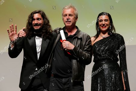 Stock Photo of Un Certain Regard Jury member, Argentine director Lisandro Alonso, French director Bruno Dumont with the Jury Special Mention award, and Un Certain Regard Jury President, Lebanese director Nadine Labaki onstage during the Closing Ceremony of Un Certain Regard, as part of the 72nd annual Cannes Film Festival, in Cannes, France, 24 May 2019. The festival runs from 14 to 25 May.
