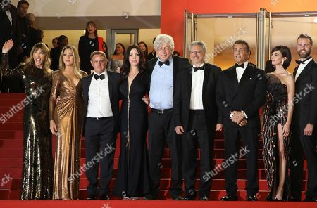 Jennifer Flavin, Sistine Rose Stallone, Kevin King, Christa Campbell, Avi Lerner, Victor Hadida, Sylvester Stallone, Paz Vega. Model Jennifer Flavin, from left, actress Sistine Rose Stallone, producer Kevin King, actress Christa Campbell, producers Avi Lerner, Victor Hadida, actors Sylvester Stallone and Paz Vega pose for photographers upon arrival at the screening of the film 'Rambo: First Blood' at the 72nd international film festival, Cannes, southern France