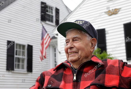 WWII veteran Peter Orlando, of Concord, Mass., who was a radioman on a tug boat that helped pull damaged ships off of the Normandy beaches during D-day, sits for a photograph in front of his home, in Concord. Orlando plans to travel to Normandy for the 75th anniversary of the D-Day Invasion