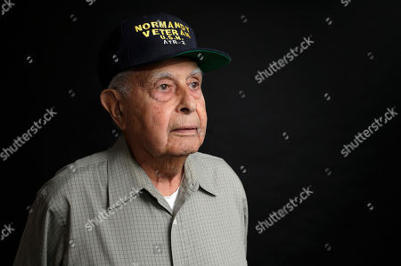 WWII veteran Peter Orlando, of Concord, Mass., who was a radioman on a tug boat that helped pull damaged ships off of the Normandy beaches during D-day, stands for a photograph at his home, in Concord. Orlando plans to travel to Normandy for the 75th anniversary of the D-Day Invasion
