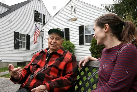 Peter Orlando, Lynn Morel. WWII veteran Peter Orlando, of Concord, Mass., left, chats with his neighbor Lynn Morel, right, in front of Orlando's home, in Concord. Orlando, who was a radioman on a tug boat that helped pull damaged ships off of the Normandy beaches during D-day, plans to travel to Normandy for the 75th anniversary of the D-Day Invasion