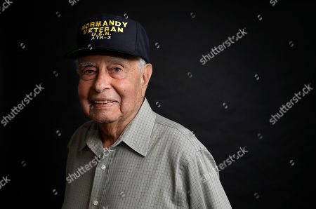 Stock Photo of WWII veteran Peter Orlando, of Concord, Mass., who was a radioman on a tug boat that helped pull damaged ships off of the Normandy beaches during D-day, stands for a photograph at his home, in Concord. Orlando plans to travel to Normandy for the 75th anniversary of the D-Day Invasion
