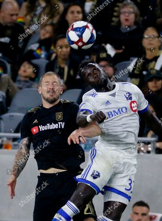 Los Angeles FC defender Jordan Harvey, left, and Montreal Impact defender Bacary Sagna (33) vie for a head ball during the second half of an MLS soccer match in Los Angeles, . The Los Angeles FC won 4-2