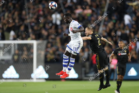 Montreal Impact defender Bacary Sagna (33) wins a header over Los Angeles FC defender Jordan Harvey (2) during the game between Montreal Impact and Los Angeles FC at Banc of California Stadium in Los Angeles, CA., USA. (Photo by Peter Joneleit)