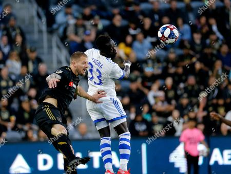 Montreal Impact defender Bacary Sagna (33) of France, and Los Angeles FC defender Jordan Harvey (2) fight for a head ball in an MLS soccer match between Los Angeles FC and Montreal Impact in Los Angeles, . LAFC won 4-2