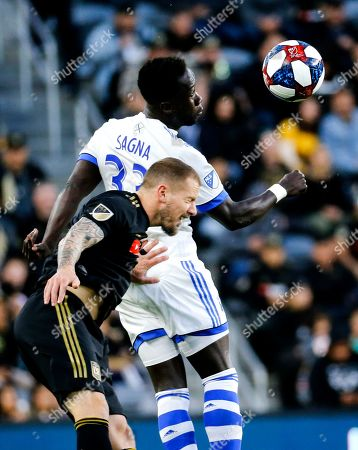 Stock Picture of Montreal Impact defender Bacary Sagna (33) of France, and Los Angeles FC defender Jordan Harvey (2) fight for a head ball in an MLS soccer match between Los Angeles FC and Montreal Impact in Los Angeles, . LAFC won 4-2