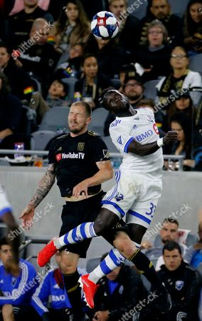 Stock Image of Los Angeles FC defender Jordan Harvey (2) and Montreal Impact defender Bacary Sagna (33) of France, fight for a head ball in an MLS soccer match between Los Angeles FC and Montreal Impact in Los Angeles, . LAFC won 4-2