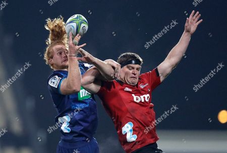 Stock Picture of Blues Tom Robinson, left, and Crusaders Scott Barrett battle for the ball during their Super Rugby match in Christchurch, New Zealand