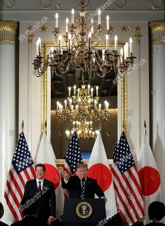 Stock Photo of President Donald Trump speaks with Japanese business leaders, in Tokyo, as U.S. Ambassador to Japan William Hagerty listens