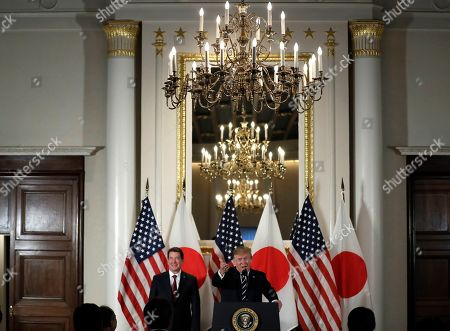 Stock Image of President Donald Trump speaks with Japanese business leaders, in Tokyo, as U.S. Ambassador to Japan William Hagerty listens