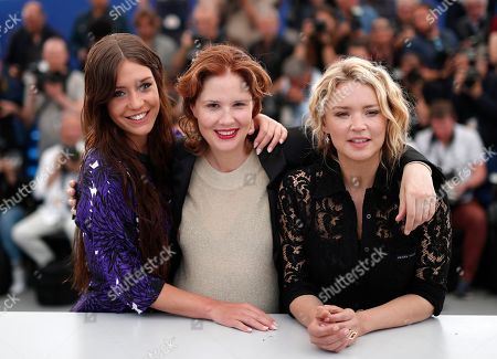 Virginie Efira (R), French director Justine Triet and French actress Adele Exarchopoulos (L) pose during the photocall for 'Sibyl' at the 72nd annual Cannes Film Festival, in Cannes, France, 25 May 2019. The movie is presented in the Official Competition of the festival which runs from 14 to 25 May.