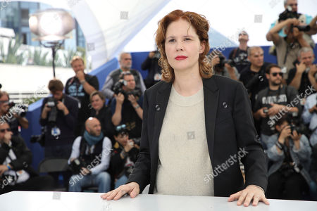 Justine Triet poses for photographers at the photo call for the film 'Sibyl' at the 72nd international film festival, Cannes, southern France