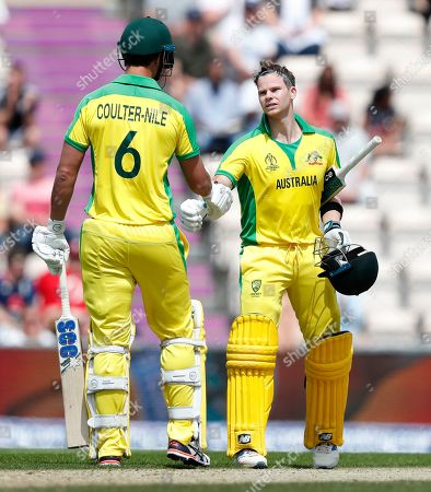 Australia's Steve Smith, right is congratulated by teammate Australia's Nathan Coulter-Nile after scoring 100 runs not out during the Cricket World Cup warm up match between England and Australia at the Rose Bowl in Southampton, England
