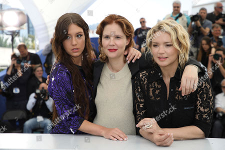 Adele Exarchopoulos, Virginie Efira, Justine Triet. Actress Adele Exarchopoulos, from left, director Justine Triet and actress Virginie Efira pose for photographers at the photo call for the film 'Sibyl' at the 72nd international film festival, Cannes, southern France