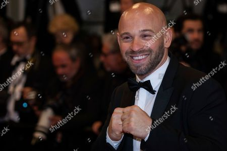 Franck Gastambide poses for photographers upon arrival at the screening of the film 'Rambo: First Blood' at the 72nd international film festival, Cannes, southern France