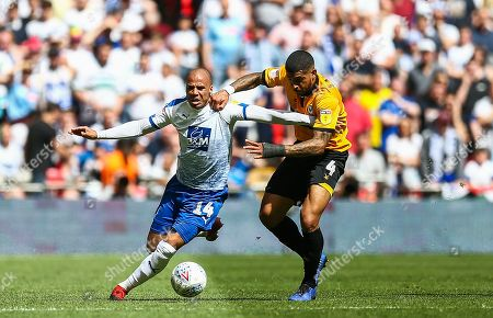 Jake Caprice of Tranmere Rovers and Joss Labadie of Newport County