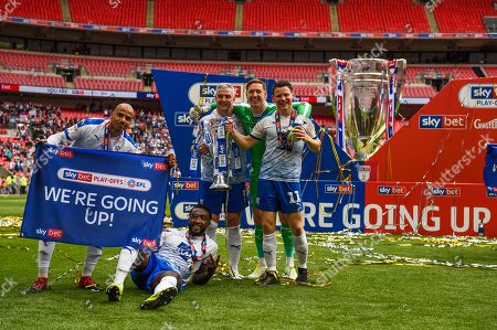 Connor Jennings, Goalkeeper Scott Davies, Steve McNulty Emmanuel Monthe and Jake Caprice of Tranmere Rovers celebrate