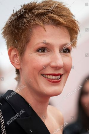 Natacha Polony poses for photographers upon arrival at the premiere of the film 'Sibyl' at the 72nd international film festival, Cannes, southern France