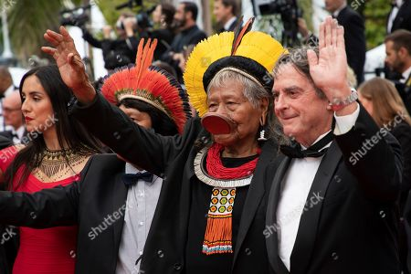 Chief Raoni Metuktire of the Kayapo people, center, poses for photographers upon arrival at the premiere of the film 'Sibyl' at the 72nd international film festival, Cannes, southern France
