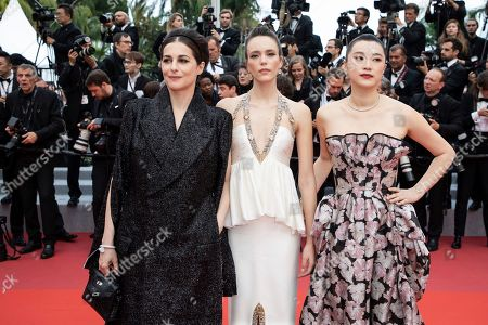 Amira Casar, Stacy Martin, Huang Lu. Actresses Amira Casar, from left, Stacy Martin and Huang Lu pose for photographers upon arrival at the premiere of the film 'Sibyl' at the 72nd international film festival, Cannes, southern France
