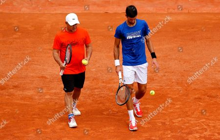 Novak Djokovic of Serbia in action with coach Marian Vajda