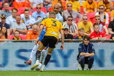 Tranmere Rovers defender Jake Caprice (14) and Newport County defender Dan Butler (3) during the EFL Sky Bet League 2 Play Off Final match between Newport County and Tranmere Rovers at Wembley Stadium, London
