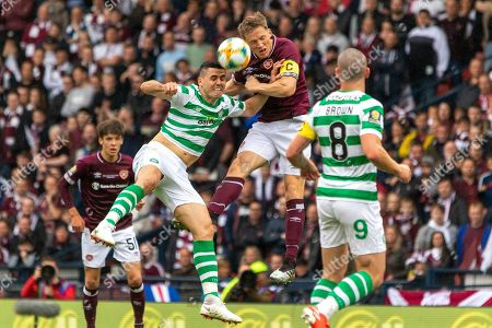 Christophe Berra of Hearts goes up for a header with Celtic's  Tom Rogic during the William Hill Scottish Cup Final match between Heart of Midlothian and Celtic at Hampden Park, Glasgow