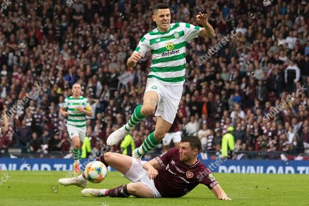 John Souttar of Hearts goes to ground to win the ball ahead of Tom Rogic of Celtic during the William Hill Scottish Cup Final match between Heart of Midlothian and Celtic at Hampden Park, Glasgow