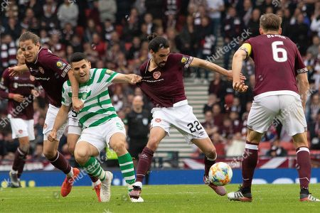 Tom Rogic of Celtic gets a handful of Ryan Edwards of Hearts shirt during the William Hill Scottish Cup Final match between Heart of Midlothian and Celtic at Hampden Park, Glasgow